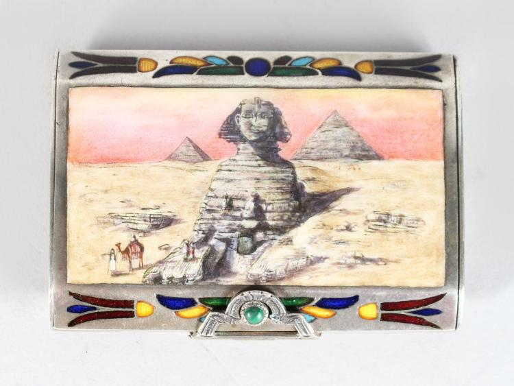 A SILVER AND ENAMEL EGYPTIAN STYLE SNUFF BOX, the lid with a sphinx. 2.75ins long.