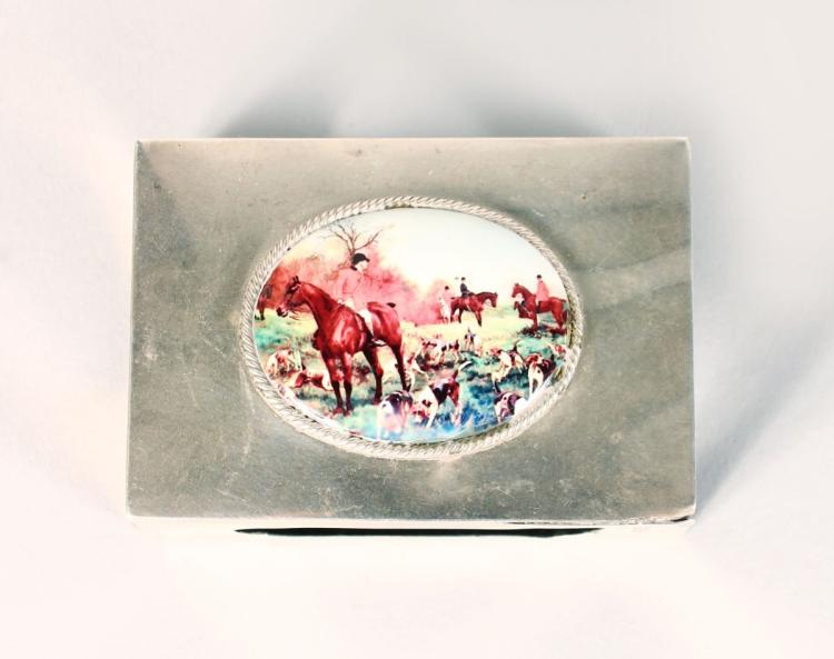 A SILVER MATCH CASE HOLDER, LONDON 1919, with an enamel of a hunting scene.