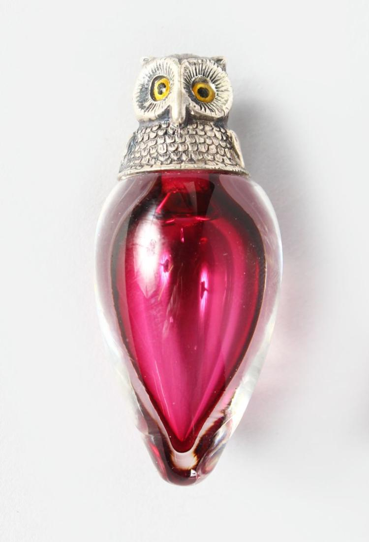 A SILVER NOVELTY CRANBERRY GLASS OWL PERFUME BOTTLE.