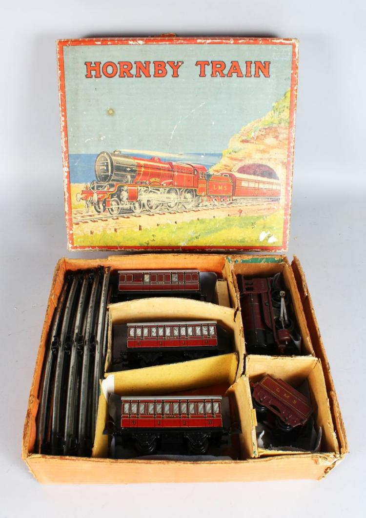 Hornby O Gauge No.1 Special Passenger Set containing locomotive, tender and three passenger cars in red livery together with a quantity of track, in the original box.