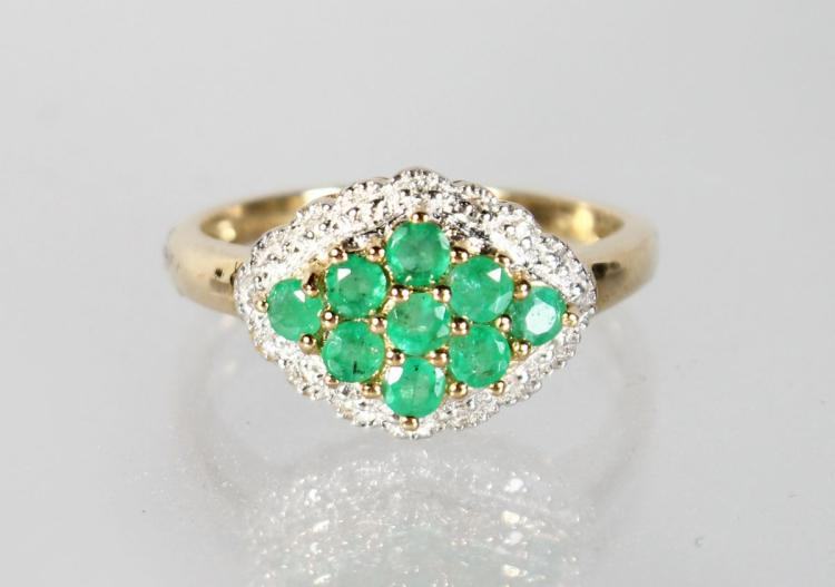 A 9CT GOLD, EMERALD AND DIAMOND RING.