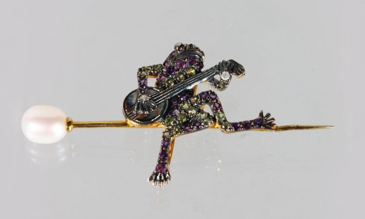 A 9CT GOLD AND SILVER FROG BROOCH set with diamonds, amethysts, peridot and pearls.