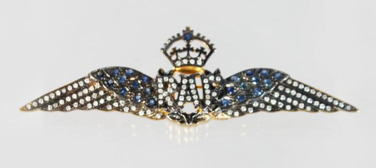 A 9CT GOLD AND SILVER, SAPPHIRE AND DIAMOND RAF BROOCH.