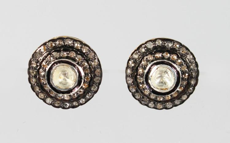 A PAIR OF 9CT GOLD AND SILVER CIRCULAR OLD CUT DIAMOND STUDS.
