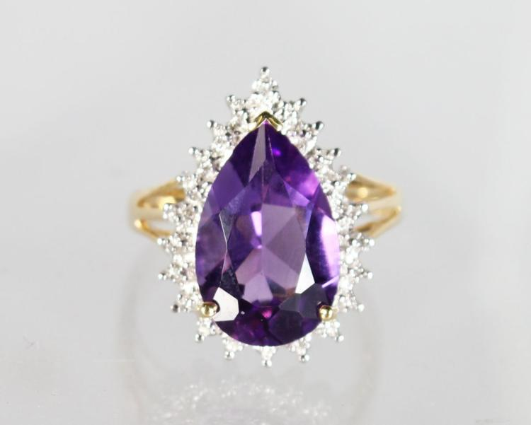 A 9ct GOLD PEAR SHAPED AMETHYST AND DIAMOND RING .