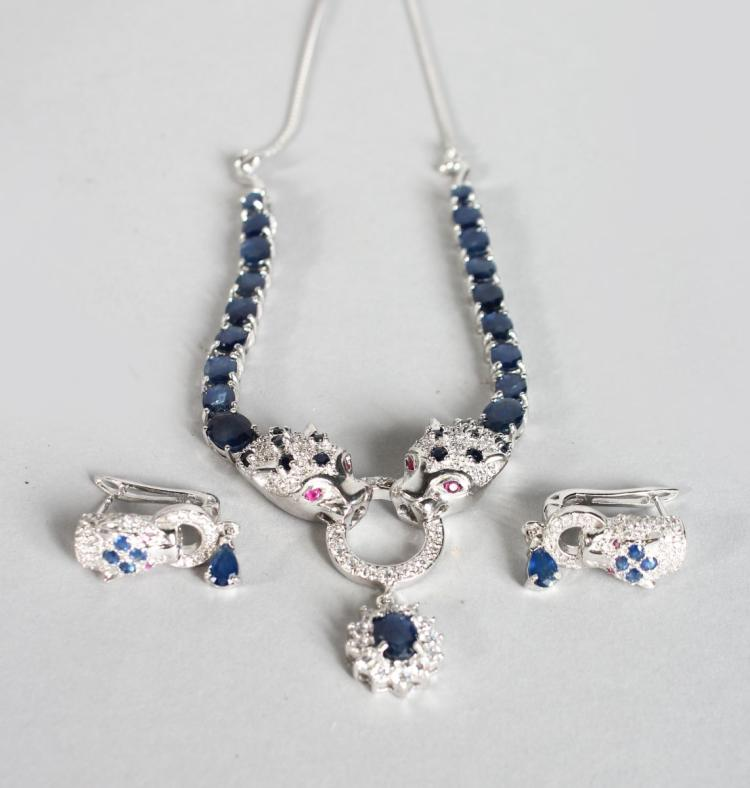 A SILVER SAPPHIRE AND RUBY PANTHER NECKLACE AND EARRINGS .