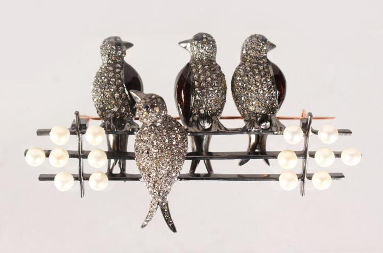 A GOOD GOLD AND SILVER BROOCH, FOUR BIRDS ON A FENCE, set with pearls and diamonds.
