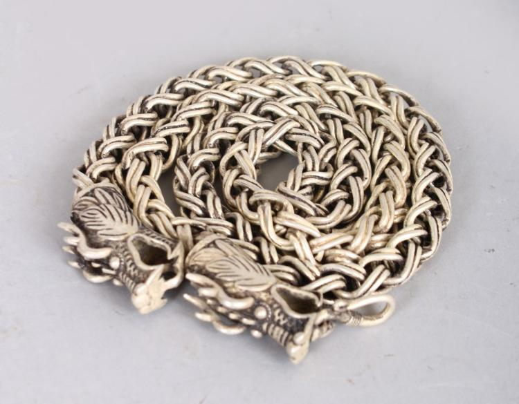 A CHINESE SILVER NECKLACE, the clasp modelled as dragons. 2ft 3ins long.