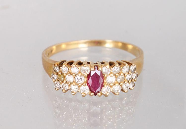 A 14K YELLOW GOLD AND DIAMOND THREE ROW DRESS RING, with a central ruby.