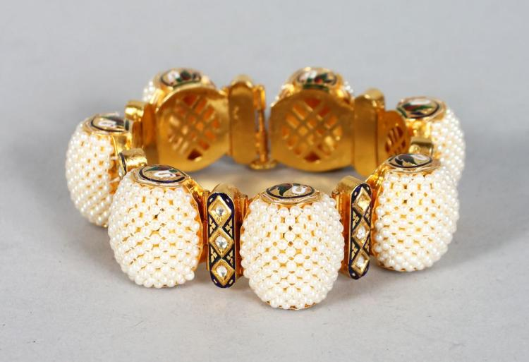 A VERY GOOD 18CT GOLD SEED PEARL, DIAMOND AND BLUE ENAMEL BRACELET, set with seven large clusters of seed pearls, interlaced with seven segments with three diamonds and blue enamel.
