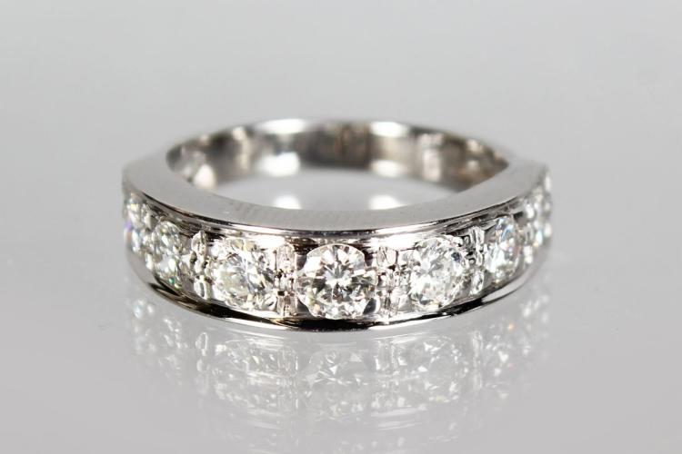 AN 18CT WHITE GOLD SEVEN STONE DIAMOND RING OF 1.3CTS.