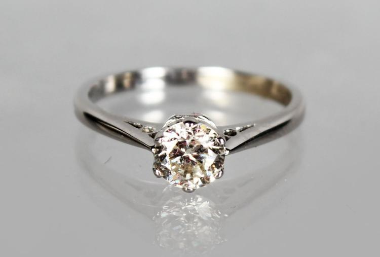 AN 18CT WHITE GOLD SOLITAIRE DIAMOND RING of 70 points, colour H, clarity Si.