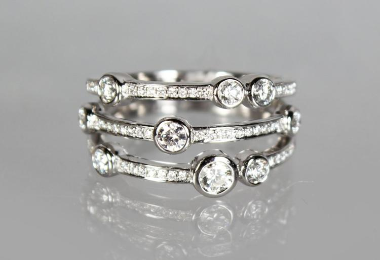 AN UNUSUAL 18CT WHITE GOLD DIAMOND TRIPLE ROW RING of 75 points.