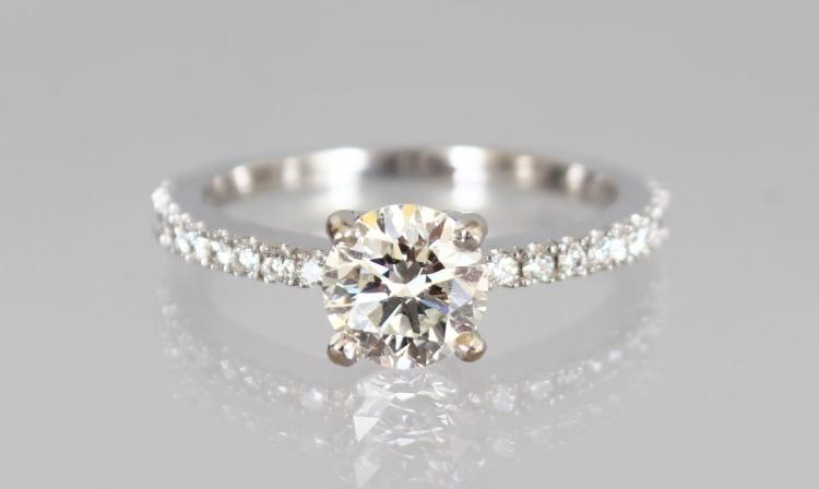 A VERY GOOD 18CT WHITE GOLD DIAMOND RING of 1.2cts, colour H, clarity VS.