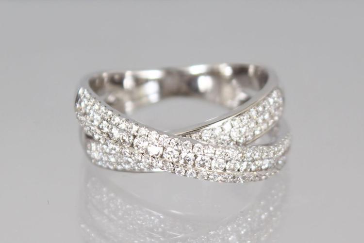 AN 18CT WHITE GOLD DIAMOND CROSS OVER RING of 75 points.