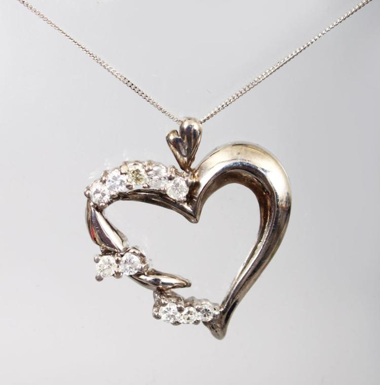 A WHITE GOLD DIAMOND SET HEART SHAPED PENDANT NECKLACE.