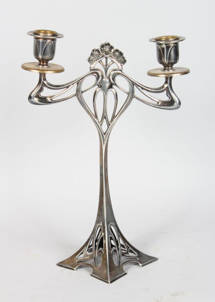 A WMF SILVER PLATED ART NOUVEAU TWIN BRANCH CANDELABRA. 12ins high.