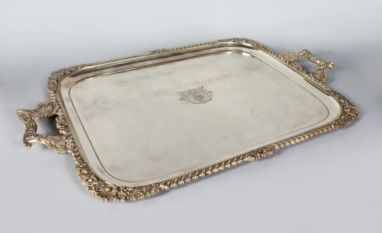 A LARGE VERY HEAVY TWO-HANDLED SILVER TEA TRAY with gadrooned edge, shell mounts, oak leaves and acorns and foliate handles, family crest, sun and cockerel in a shield. Sheffield 1935. Maker: Mappin and Webb. Weight 210ozs.