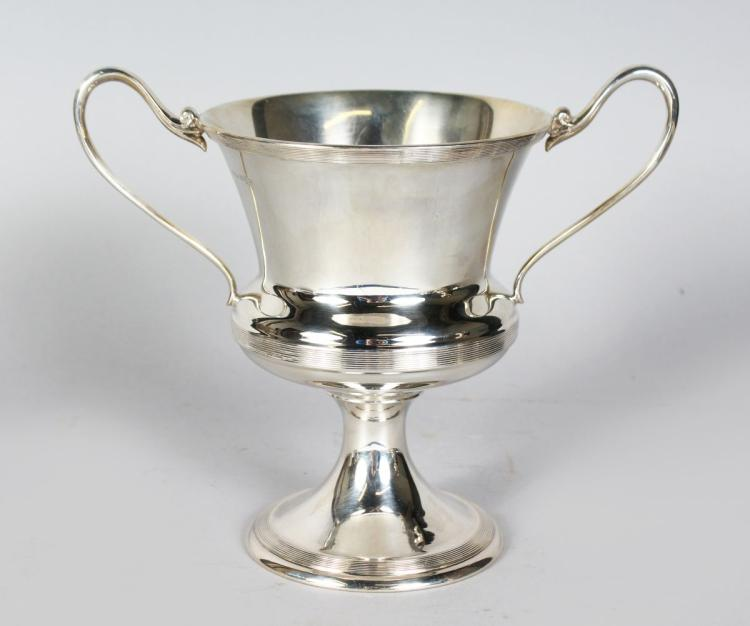 A TWO-HANDLED CHALICE CUP with reeded bands. 7.5ins high. Sheffield 1937. Makers: James Deakin & Son. Weight 20ozs.