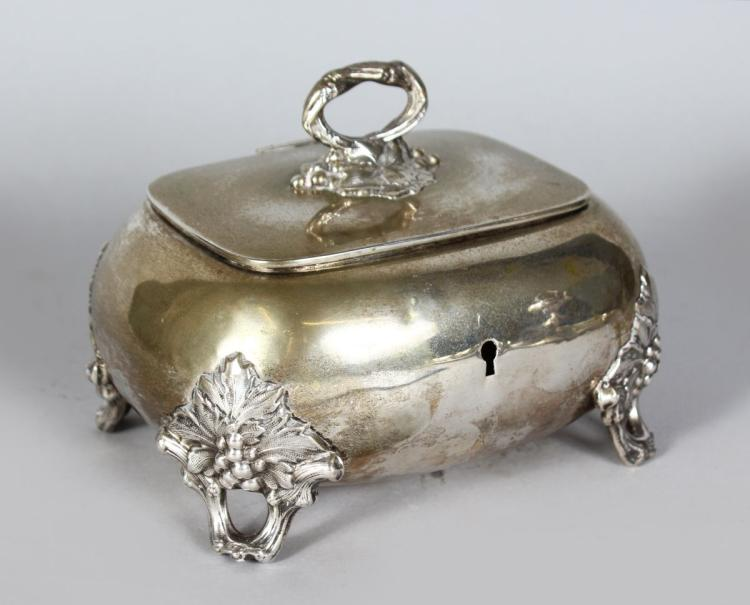 A CONTINENTAL SILVER .750 BOX AND COVER with fruiting vine handle and feet. 6ins long.