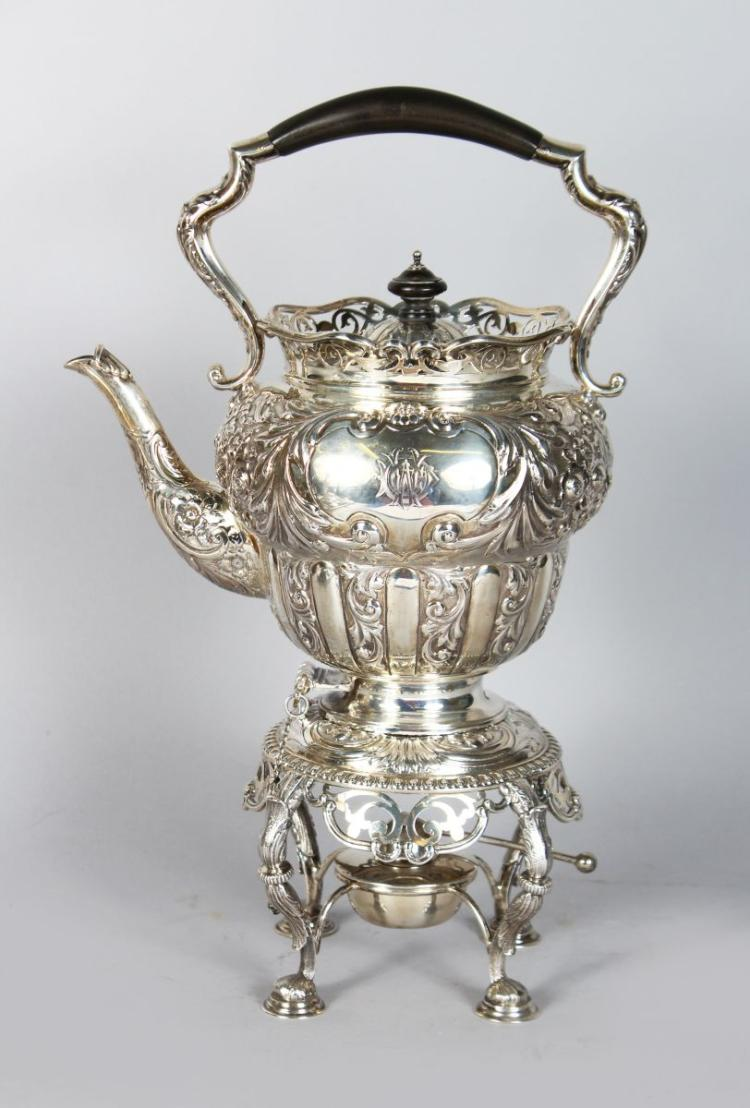 A GOOD VICTORIAN TEA KETTLE ON STAND with floral repousse decoration and acanthus. Birmingham 1886. Maker: Alexander Clark. Weight 68ozs.