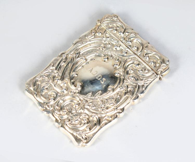 A VICTORIAN SILVER CALLING CARD CASE, with hinged lid and embossed decoration. Birmingham 1905. 4ins x 3ins.
