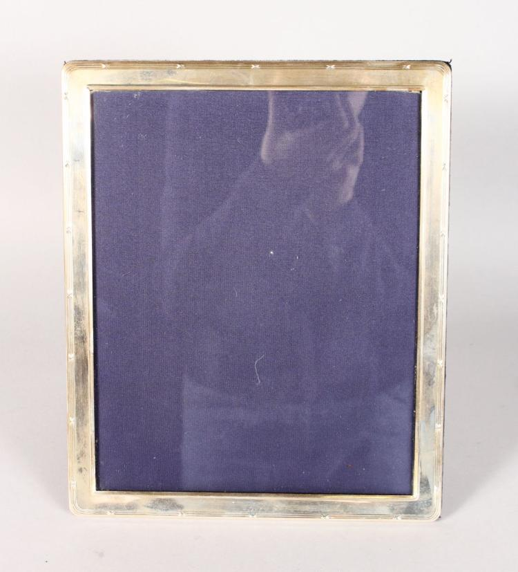 AN UPRIGHT PHOTOGRAPH FRAME with reeded edge. 11ins high x 9ins wide.