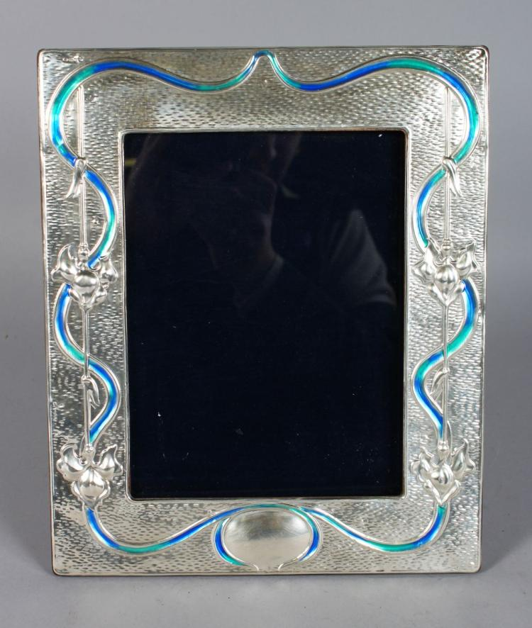 A SILVER AND BLUE ENAMEL PHOTOGRAPH FRAME. 11.5ins x 8ins.