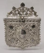 A 19TH CENTURY INDO-PERSIAN SILVER METAL BOX, with hinged lid, cast in reli