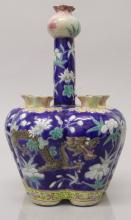 A GOOD QUALITY 19TH CENTURY CHINESE FAMILLE ROSE BLUE GROUND PORCELAIN TULI