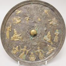 ANOTHER CHINESE TANG STYLE GILDED & SILVERED BRONZE MIRROR, decorated in re