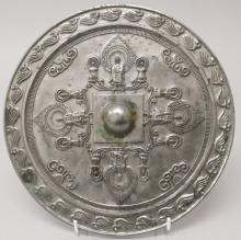 ANOTHER CHINESE TANG STYLE SILVERED BRONZE MIRROR, decorated in relief with