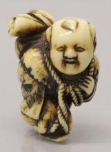 A GOOD SIGNED EARLY 19TH CENTURY JAPANESE EDO PERIOD CARVED IVORY NETSUKE O