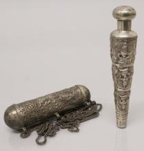 A SOUTH-EAST ASIAN SILVER-METAL CANE HANDLE, decorated in relief with repea