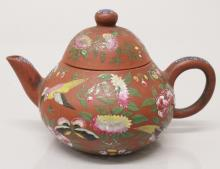 A 19TH CENTURY SIGNED CHINESE CANTON DECORATED YIXING POTTERY TEAPOT & COVE