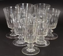 A SET OF EIGHT LARGE WINE GLASSES.