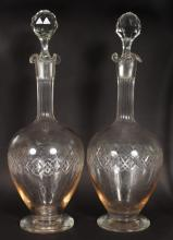 A PAIR OF ENGRAVED SHERRY DECANTERS AND STOPPERS.