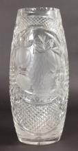 A LARGE CUT GLASS FLOWER VASE engraved with two large panels of fruit. <br>15ins high.