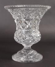 A HEAVY CUT GLASS THISTLE SHAPED FLOWER VASE. <br>10ins high.