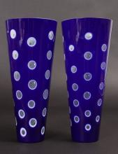 A PAIR OF BLUE AND WHITE TAPERING VASES. <br>9.5ins high.