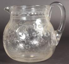 A LARGE STEVENS & WILLIAMS CUT GLASS WATER JUG with scrolls and flowers. <br>6.5ins high.