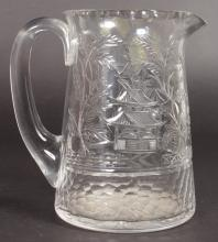 A STEVENS & WILLIAMS CUT GLASS CLARET JUG, cut with willow design. <br>6.5ins high.