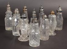 TEN GEORGIAN BOTTLES, some with silver tops.