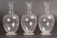 THREE ENGRAVED CARAFES.