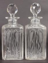 A PAIR OF WHISKY DECANTERS AND STOPPERS engraved with wheat ears.