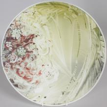 HAROLD ELVIN (20TH CENTURY) BRITISH <br>A LARGE MILK GLASS CIRCULAR DISH, 16.5ins diameter, painted with flowers. <br>Signed and dated '66.
