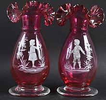A PAIR OF MARY GREGORY TYPE RUBY GLASS VASES