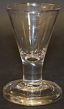A GEORGIAN DRAM GLASS with funnel bowl and short