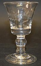 A GEORGIAN WINE GLASS with engraved bowl and knop