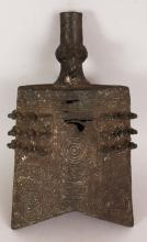 AN EARLY 20TH CENTURY CHINESE SHANG STYLE BRONZE BELL, cast with archaic patterns and with studs in high relief, 6.3in wide at widest point & 10.8in high.